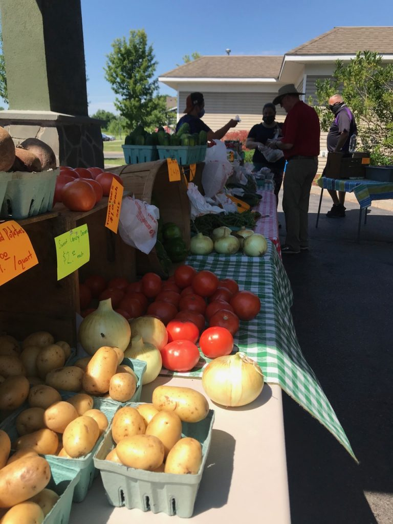 Farmers table of fresh fruits and veggies