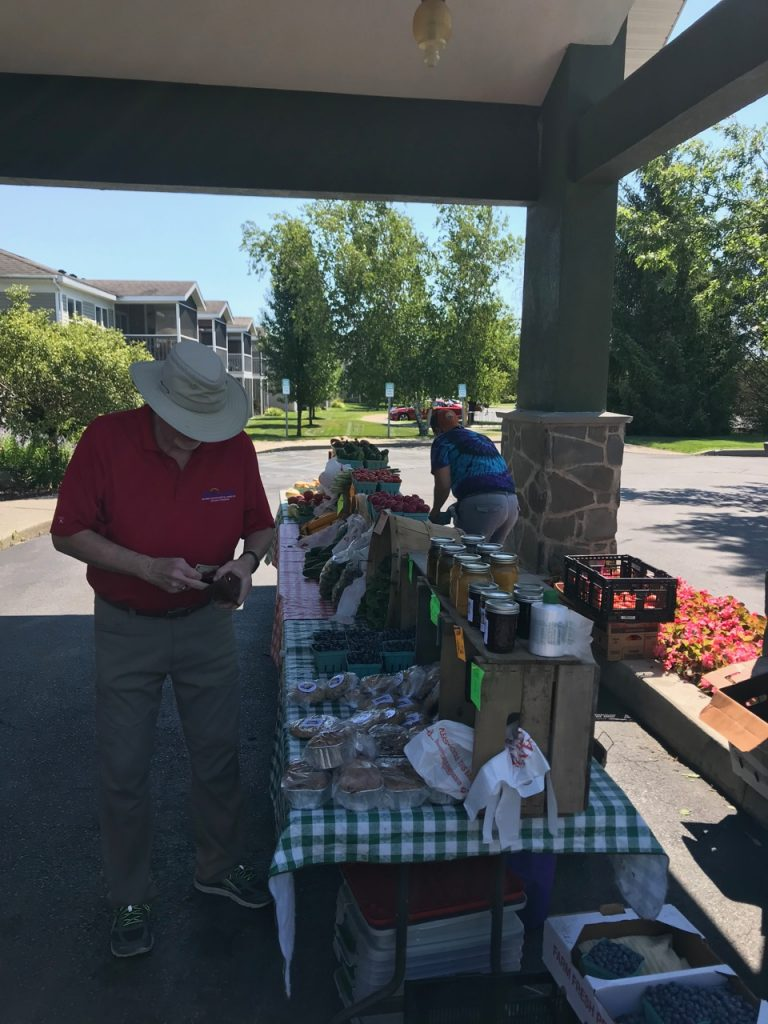 Resident supporting local farmers market