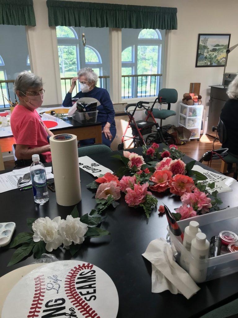 Residents creating door art with flowers