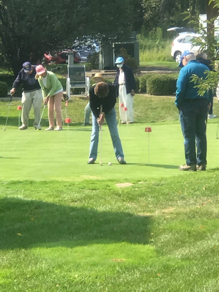 Residents in putting contest.